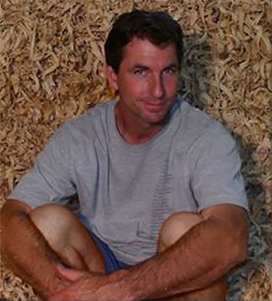 mike mahoney in front of wood shavings
